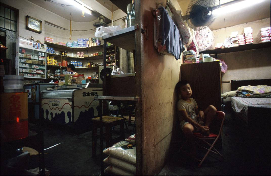 Young boy in living area in back of family shop, 1990