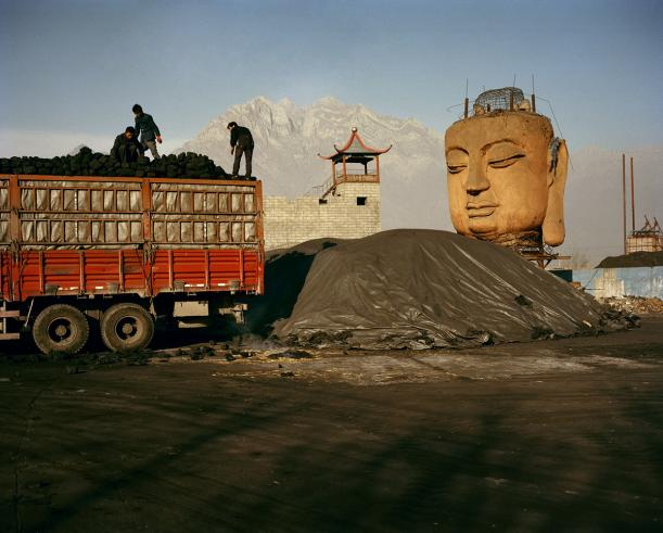 Buddha Head in Coal Yard, Ningxia. 'Can China Go Green'?, National Geographic, June 2011